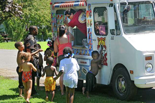 Kids ran fast out of the splash park when they heard the ice cream truck pull up in Lincoln Park on Friday, July 31, 2015 in Albany, N.Y.  (Lori Van Buren / Times Union) Photo: Lori Van Buren / 10032853A