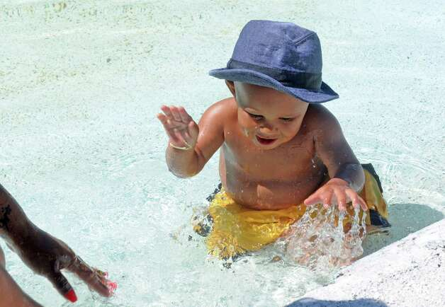 Eight-month-old Carter Jackson of Schenectady splashes about in the pool at Central Park on Friday July 31, 2015 in Schenectady, N.Y. (Michael P. Farrell/Times Union) Photo: Michael P. Farrell / 10032853A