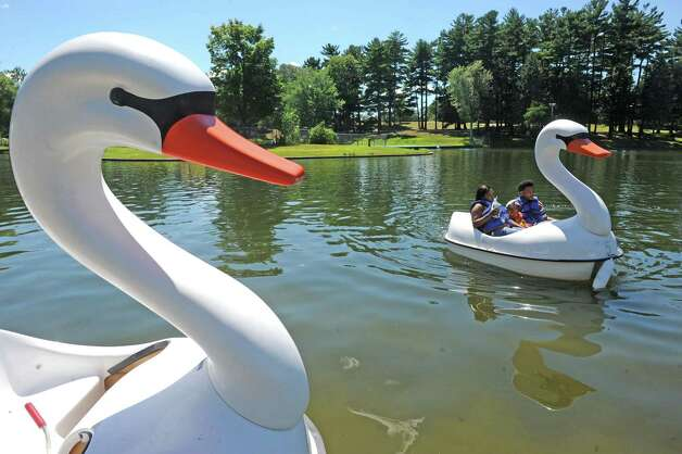 The Davie family of Albany Marshe, Xavier and their three-year-old son Javier take a swan paddleboat ride at the lake in  Central Park on Friday July 31, 2015 in Schenectady, N.Y. (Michael P. Farrell/Times Union) Photo: Michael P. Farrell / 10032853A