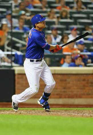 NEW YORK, NY - JULY 31:  Wilmer Flores #4 of the New York Mets connects on a  twelfth inning walk-off home run against the Washington Nationals at Citi Field on July 31, 2015 in Flushing neighborhood of the Queens borough of New York City. Mets defeated the Nationals 2-1 in 12 innings.  (Photo by Mike Stobe/Getty Images) ORG XMIT: 538587739 Photo: Mike Stobe / 2015 Getty Images