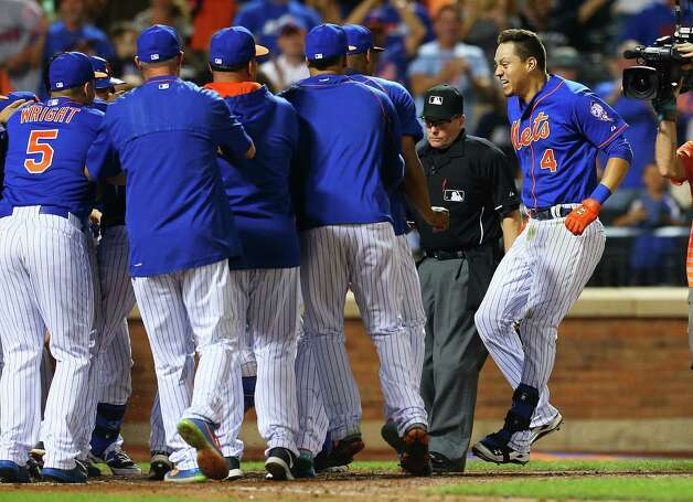 NEW YORK, NY - JULY 31:  Wilmer Flores #4 of the New York Mets celebrates after hitting a twelfth inning walk-off home run against the Washington Nationals at Citi Field on July 31, 2015 in Flushing neighborhood of the Queens borough of New York City. Mets defeated the Nationals 2-1 in 12 innings.  (Photo by Mike Stobe/Getty Images) ORG XMIT: 538587739 Photo: Mike Stobe / 2015 Getty Images