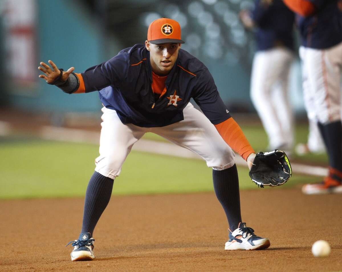Houston Astros right fielder George Springer (4) fields a ball at first base during batting practice before the start of an MLB game at Minute Maid Park on Friday, July 31, 2015, in Houston. ( Karen Warren / Houston Chronicle )