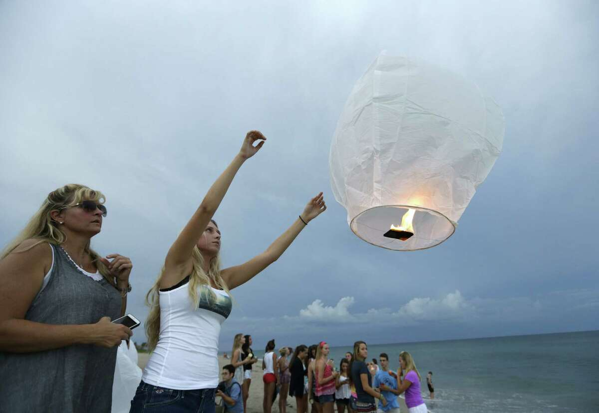 A lantern is released during a vigil this week in Stuart, Fla., for 14-year-olds Austin Stephanos and Perry Cohen, who have been missing for a week.