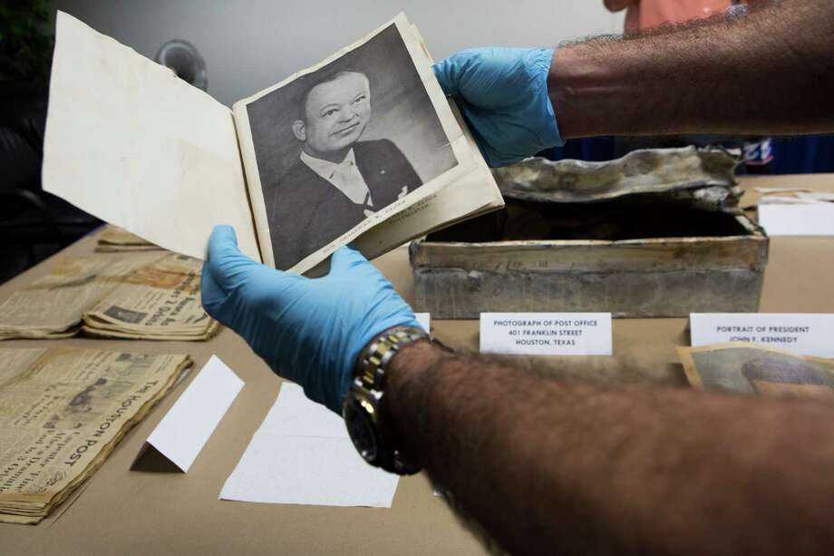 Allen McHenry, a United States Postal Inspector holds a portrait Post Master Granville Elder that was found inside a time capsule that had been placed inside the United States Postal Service Houston Main Post Office in 1962. Friday, July 31, 2015, in Houston . Photo: Marie D. De Jesus, Houston Chronicle / © 2015 Houston Chronicle