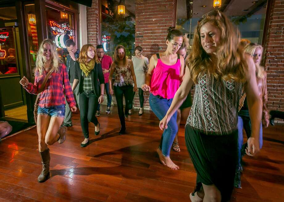 Line dancing being taught at Overland Country Western Bar in Oakland. Photo: John Storey, Special To The Chronicle