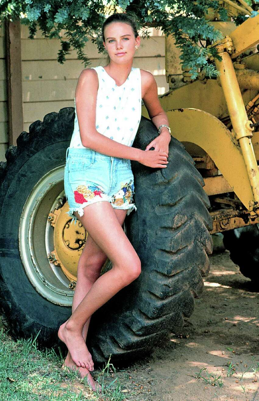 South African native Charlize Theron, born Aug. 7, 1975, is one of the premier actresses of her generation, with an Oscar and a Golden Globe in her possession and a career that continues to impress. Here she poses with a tractor outside her home in her hometown ofBenoni, South Africa,on Jan. 20, 1992, age 16. Two years later she moved to Hollywood and started on the path to stardom.