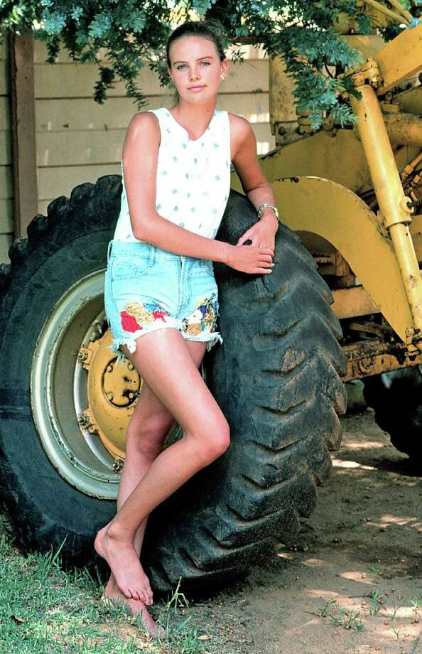 South African native Charlize Theron, born Aug. 7, 1975, is one of the premier actresses of her generation, with an Oscar and a Golden Globe in her possession and a career that continues to impress. Here she poses with a tractor outside her home in her hometown of Benoni, South Africa, on Jan. 20, 1992, age 16. Two years later she moved to Hollywood and started on the path to stardom. Photo: Gallo Images, Getty Images / 2010 Gallo Images