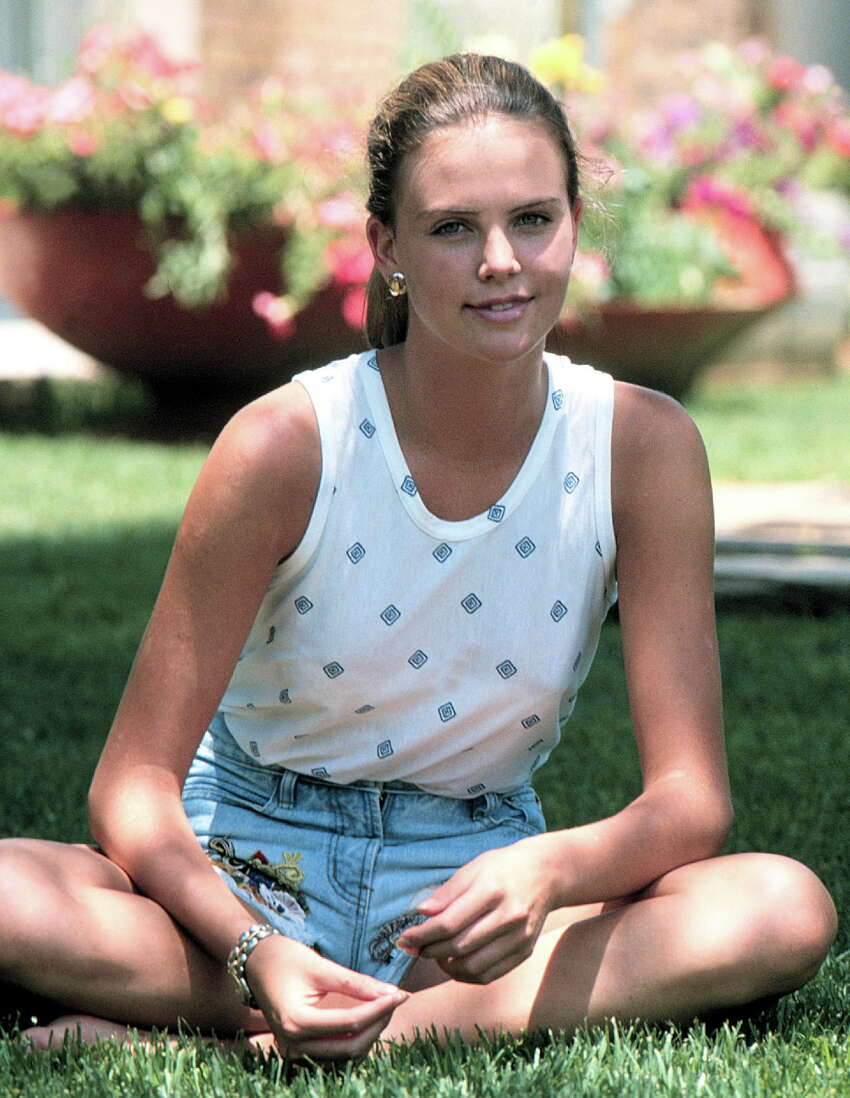 Charlize Theron poses outside her home on Jan. 20, 1992.
