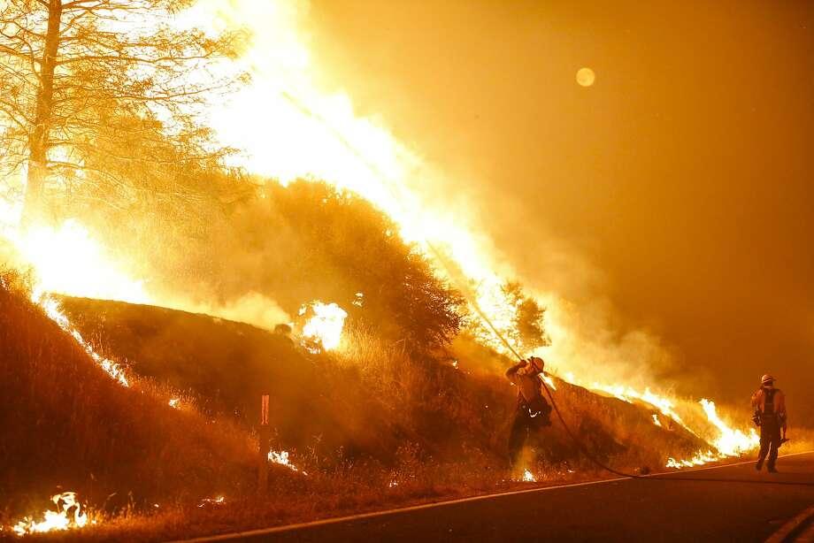Firefighters battle the Rocky Fire along Morgan Valley Road near Lower Lake, Calif., on Friday, July 31, 2015. Photo: Loren Elliott, The Chronicle