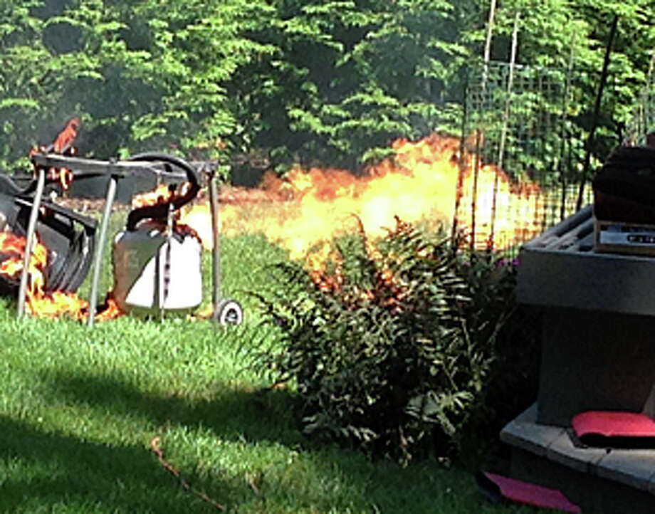 Flames leap from a gas grill that caught fire at a Janson Drive home Firday. Photo: Contributed Photo / Contributed Photo / Westport News