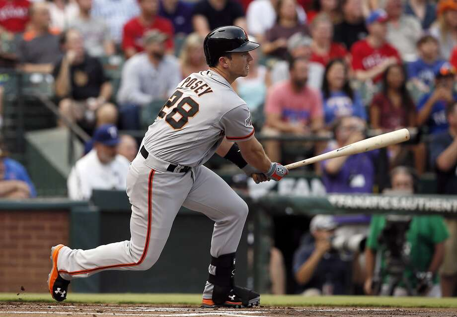 San Francisco Giants' Buster Posey follows through on a single up the middle against the Texas Rangers in the first inning of a baseball game Friday, July 31, 2015, in Arlington, Texas. (AP Photo/Tony Gutierrez) Photo: Tony Gutierrez, Associated Press