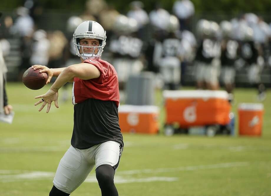 Derek Carr threw only 12 interceptions last year, an all-time NFL best for rookie QBs with at least 450 pass attempts. Photo: Eric Risberg, Associated Press