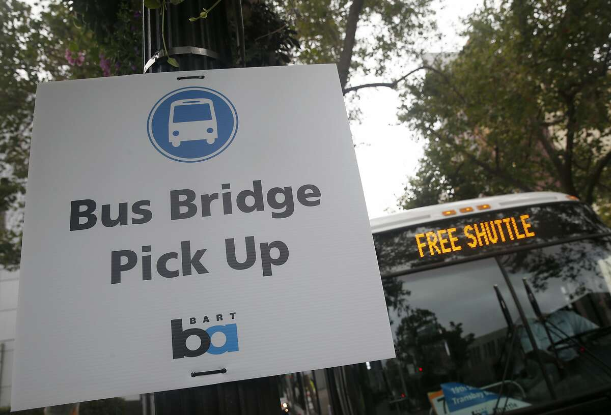 A bus bridge to San Francisco is set up at the 19th Street BART station in Oakland, Calif. on Saturday, Aug. 1, 2015. BART has shut down transbay service for the weekend to perform major track maintenance between the West Oakland station and the entrance to the tube.