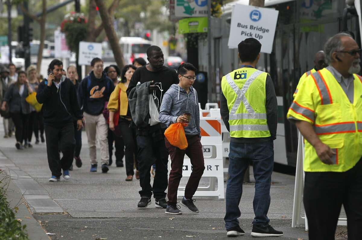 San Francisco bound passengers transfer to a bus at the 19th Street BART station in Oakland, Calif. on Saturday, Aug. 1, 2015. BART organized the bus bridge while transbay service is shut down for the weekend to perform major track maintenance between the West Oakland station and the entrance to the tube.