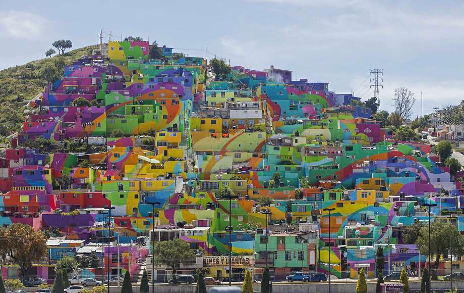 Hundreds of houses in the Las Palmitas neighborhood of the town of Pachuca are painted in vivid colors in what organizers say is Mexico's largest mural. Photo: Sofia Jaramillo, Associated Press