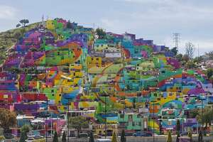 Enormous mural brightens, unites Mexican neighborhood - Photo