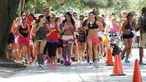 Runners start the race at the 2015 Hot Undies Run Saturday, Aug. 1, 2015, in Houston.