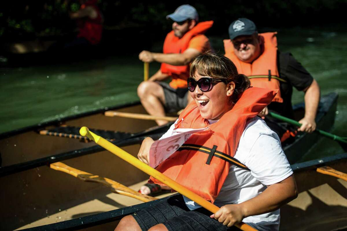 Paddlers take off at the start of a heat during the