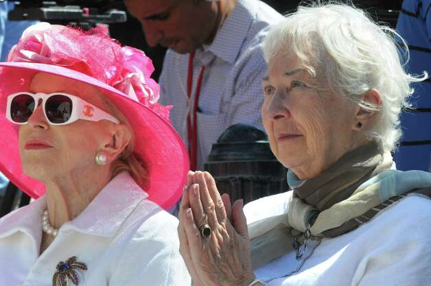 "MaryLou Whitney , left, sits with Gwen Reardon as the ""Native Dancer"" statue is unveiled at Congress Park's Centennial Park on Saturday Aug. 1, 2015 in Saratoga Springs, N.Y. The statue was donated by by MaryLou Whitney and John Hendrickson and created by equine artist Gwen Reardon. (Michael P. Farrell/Times Union) Photo: Michael P. Farrell / 10032851A"