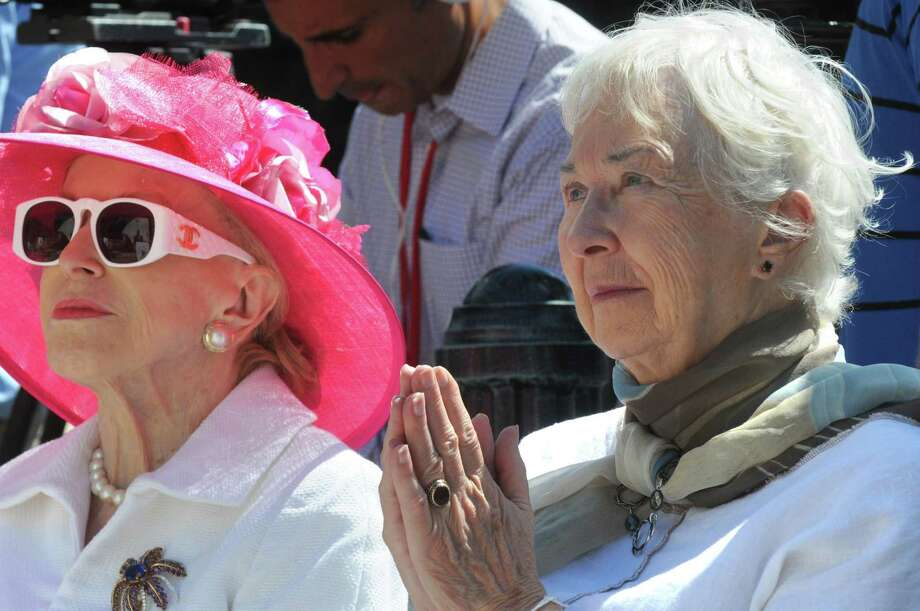 """MaryLou Whitney , left, sits with Gwen Reardon as the """"Native Dancer"""" statue is unveiled at Congress Park's Centennial Park on Saturday Aug. 1, 2015 in Saratoga Springs, N.Y. The statue was donated by by MaryLou Whitney and John Hendrickson and created by equine artist Gwen Reardon. (Michael P. Farrell/Times Union) Photo: Michael P. Farrell / 10032851A"""