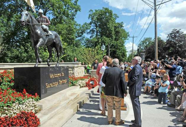 "The ""Native Dancer"" statue is unveiled at Congress Park's Centennial Park on Saturday Aug. 1, 2015 in Saratoga Springs, N.Y. The statue was donated by by MaryLou Whitney and John Hendrickson and created by equine artist Gwen Reardon. (Michael P. Farrell/Times Union) Photo: Michael P. Farrell / 10032851A"