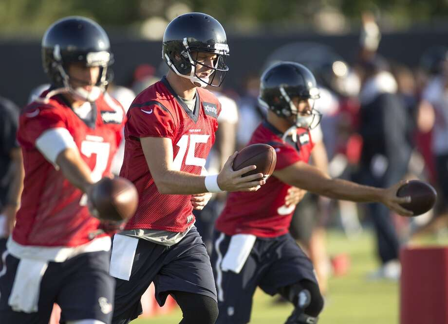 Houston Texans quarterbacks Brian Hoyer (7), Ryan Mallett (15) and Tom Savage (3) warm up during Texans training camp at the Methodist Training Center Saturday, Aug. 1, 2015, in Houston.  ( Brett Coomer / Houston Chronicle ) Photo: Brett Coomer, Houston Chronicle