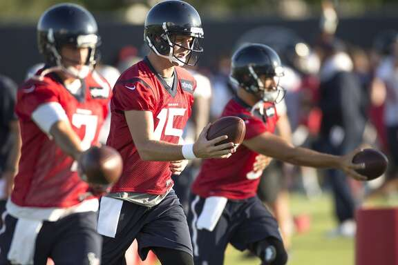 Houston Texans quarterbacks Brian Hoyer (7), Ryan Mallett (15) and Tom Savage (3) warm up during Texans training camp at the Methodist Training Center Saturday, Aug. 1, 2015, in Houston.  ( Brett Coomer / Houston Chronicle )