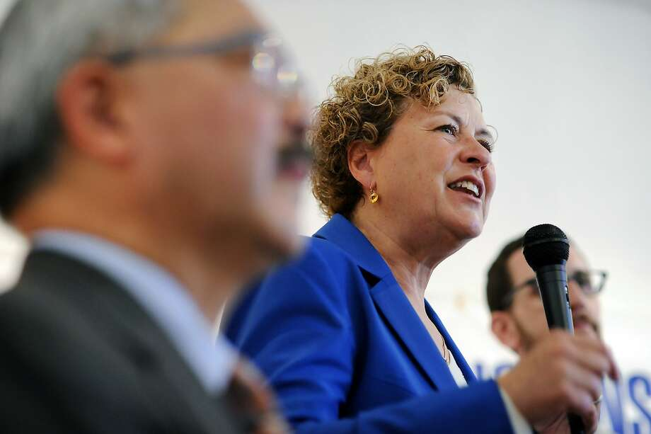 Mayor Ed Lee, left, looks on as supervisor Julie Christensen gives a speech during a kick-off celebration for Christensen's district-3 supervisor re-election campaign, in San Francisco, CA Saturday, August 1, 2015. Photo: Michael Short, Special To The Chronicle