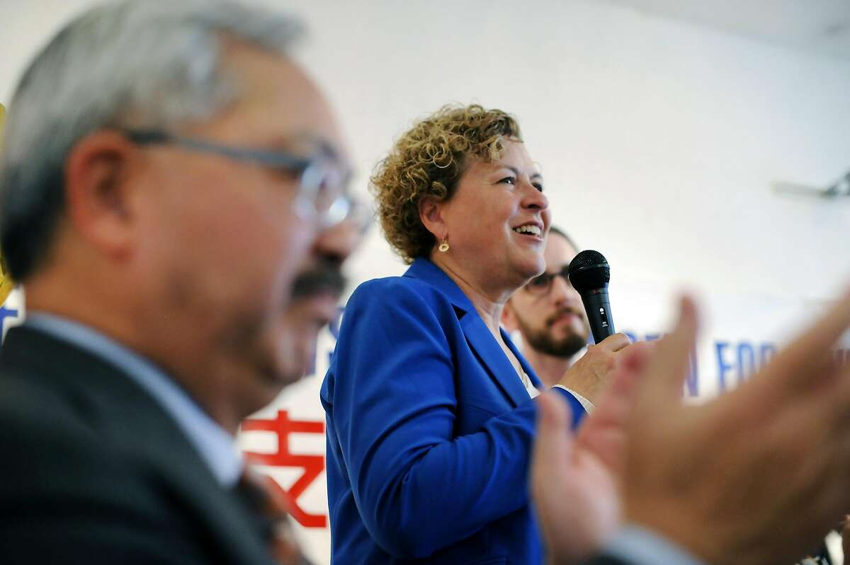 Mayor Ed Lee, left, claps as supervisor Julie Christensen speaks to the crowd during a kick-off celebration for Christensen's district-3 supervisor re-election campaign earlier this month. She won the endorsement of the San Francisco Democratic Central Committee over progressive favorite Aaron Peskin.