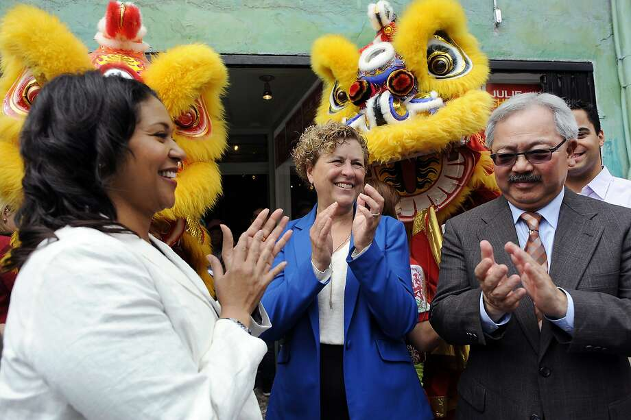 Supervisors London Breed, left, Julie Christensen, and  Mayor Ed Lee clap during a kick-off celebration for Christensen's district-3 supervisor re-election campaign, in San Francisco, CA Saturday, August 1, 2015. Photo: Michael Short, Special To The Chronicle