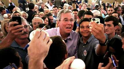 2016 Republican presidential candidate Jeb Bush greets supporters  during a campaign rally at the Maitland Venue in Maitland, Fla., Monday, July 27, 2015. (Joe Burbank/Orlando Sentinel via AP) MAGS OUT, NO SALES MANDATORY CREDIT