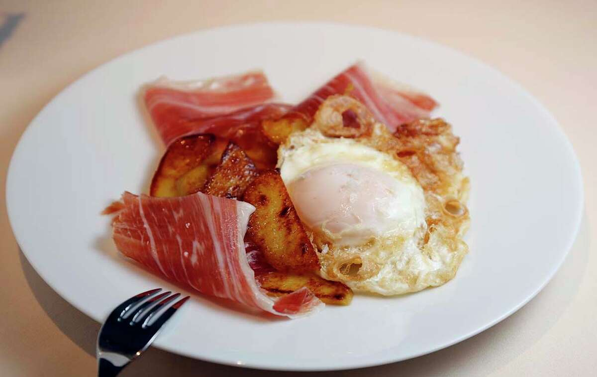 The Eggs Estrellados with potatoes and cured Spanish Iberico Ham at BCN Taste & Tradition.