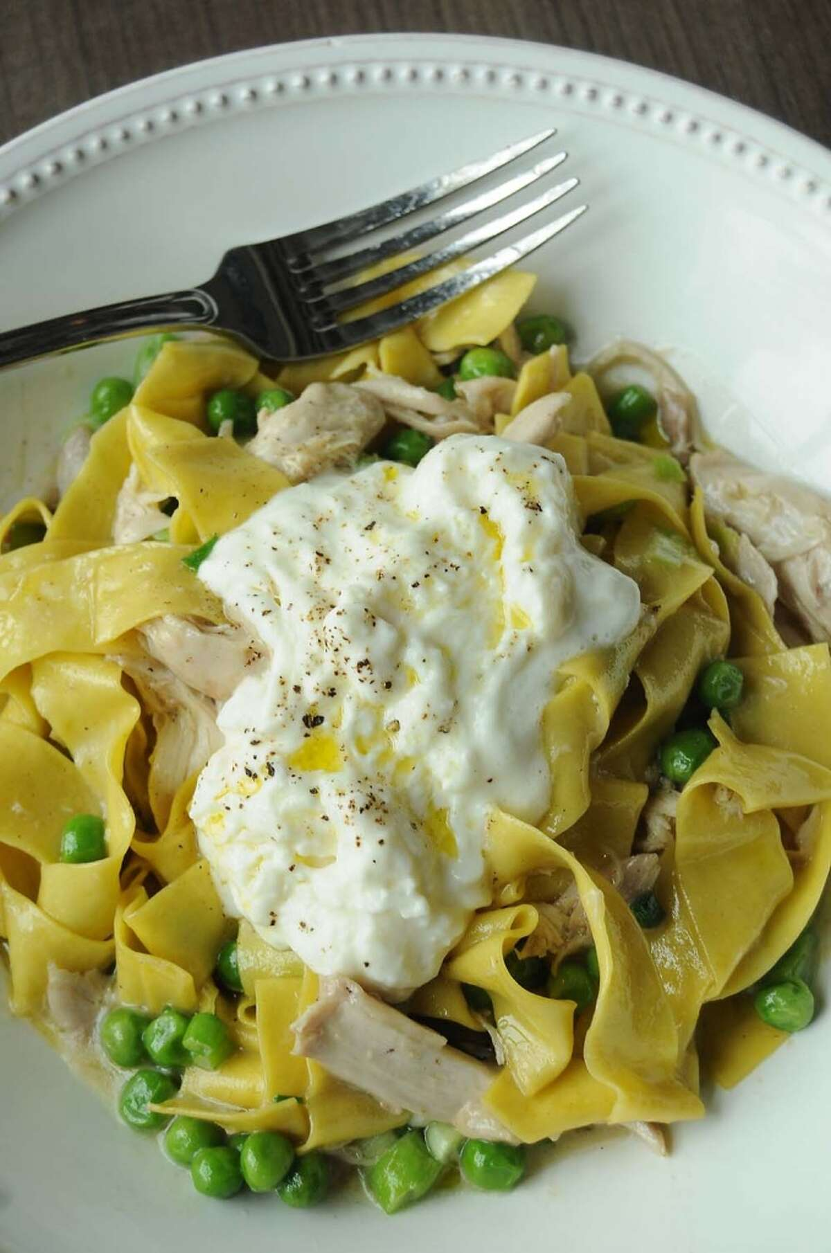 The confit rabbit with homemade papparedelle, fresh peas, scallions and buratta cheese at Weights + Measures.