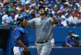 TORONTO, CANADA - AUGUST 1: Ben Zobrist #18 of the Kansas City Royals celebrates after hitting a solo home run in the first inning during MLB game action against the Toronto Blue Jays on August 1, 2015 at Rogers Centre in Toronto, Ontario, Canada. (Photo by Tom Szczerbowski/Getty Images)
