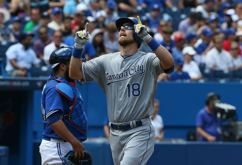 Royals utility man Ben Zobrist, obtained from the A's for pitching prospects Sean Manaea and Aaron Brooks, celebrates after the first of his two solo home runs in Toronto on Saturday. Photo: Tom Szczerbowski, Getty Images