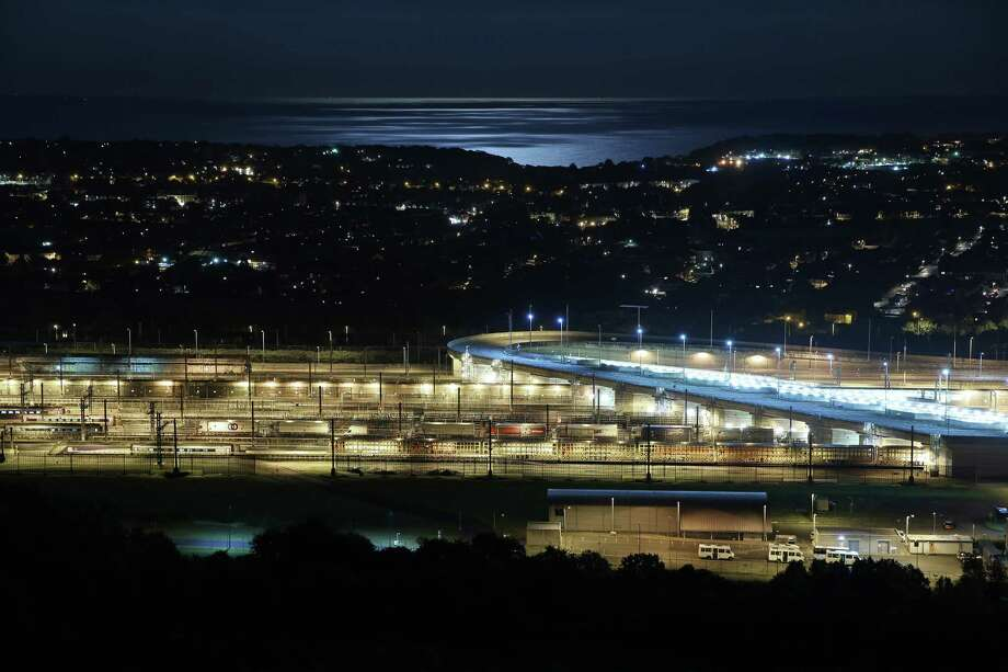 FOLKESTONE, ENGLAND - JULY 31:  The English Chanel is illuminated by a rare blue moon next to the Eurotunnel terminal on July 31, 2015 in Folkestone, England. Hundreds of migrants are continuing to attempt to enter the Channel Tunnel in Calais, France and onto trains heading to the United Kingdom. Photo: Peter Macdiarmid, Getty Images / 2015 Getty Images