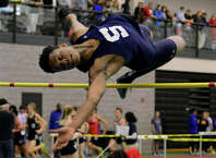 Staples' Anthony Bravo competes in the high jump, during FCIAC track championship action in New Haven, Conn. on Tuesday Feb. 5, 2015.