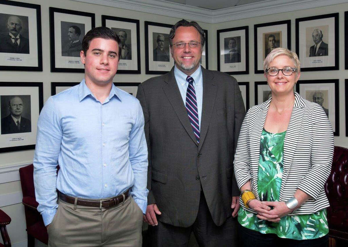 Quinnipiac University student Marc Steinberg, of Greenwich, left, Hamden Mayor Curt Balzano Leng and the Mayor's Chief of Staff Julie Smith. Steinberg was one of five Quinnipiac students to have spent the last nine weeks getting a firsthand look at how municipal government works as part of the university's Presidential Public Service Fellowship Program, a course that gives students the opportunity to work in municipal government offices with a department head as a mentor-supervisor.