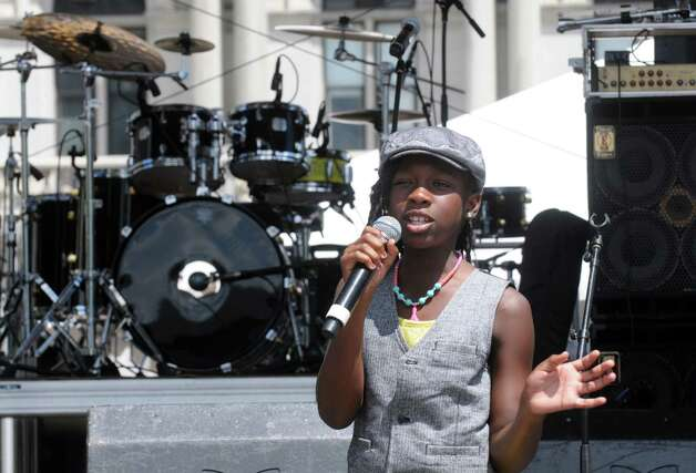 Nine-year-old Sydni Jordan performs in the Plaza Lites Talent Competition Winner show during the Black Arts and Cultural Festival at the Empire State Plaza on Saturday Aug. 1, 2015 in Albany, N.Y. (Michael P. Farrell/Times Union) Photo: Michael P. Farrell / 10032814A