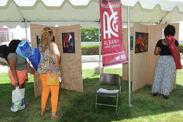 The Albany Center Gallery satellite art exhibit during the Black Arts and Cultural Festival at the Empire State Plaza on Saturday Aug. 1, 2015 in Albany, N.Y. (Michael P. Farrell/Times Union) Photo: Michael P. Farrell / 10032814A