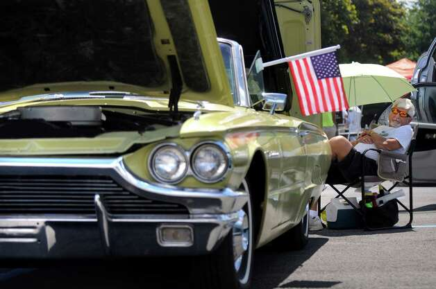Veteran Art Dahoda of Halfmoon tends his 1964 Ford Thunderbird convertible during the 6th Annual Honor Our Vets Car Show on Saturday, Aug. 1, 2015, at Stratton VA Medical Center in Albany, N.Y. (Cindy Schultz / Times Union) Photo: Cindy Schultz / 10032823A