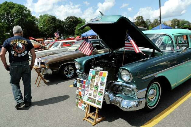 A 1956 Chevy 210, right, owned by Pete and June Danner of Valatie, is part of the 6th Annual Honor Our Vets Car Show on Saturday, Aug. 1, 2015, at Stratton VA Medical Center in Albany, N.Y. (Cindy Schultz / Times Union) Photo: Cindy Schultz / 10032823A