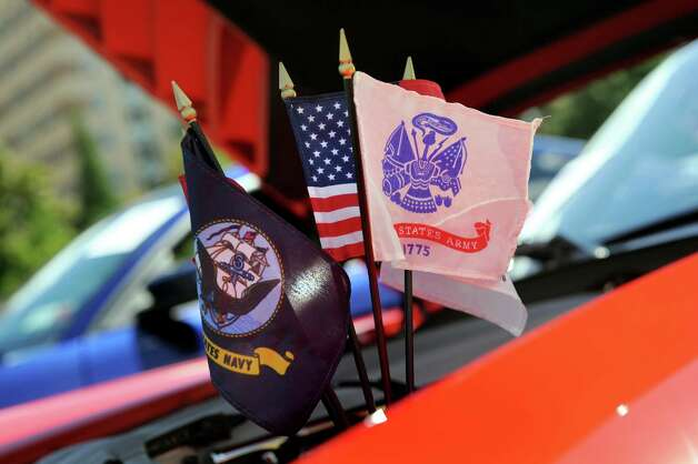Flags fly from the engine of a 2003 Dodge Viper SRT-10, owned by Derek Bowman of Amsterdam, during the 6th Annual Honor Our Vets Car Show on Saturday, Aug. 1, 2015, at Stratton VA Medical Center in Albany, N.Y. (Cindy Schultz / Times Union) Photo: Cindy Schultz / 10032823A