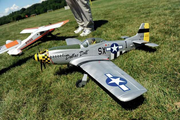 The Dallas Doll, left, modeled after the WWII Mustang, and the Beaver electric powered aircraft are part of the All-Electric Radio Control Model Air Show on Saturday, Aug. 1, 2015, at Maalwyck Park in Glenville, N.Y. Modelers from around the region took part in the event organized by the Electric Powered Aeromodelers Club of Glenville. (Cindy Schultz / Times Union) Photo: Cindy Schultz / 10032822A