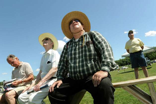 Martin K. Manley of Schenectady, center, and his friend Jim Cronin of Scotia, second from left, keep their eyes to the skies during the All-Electric Radio Control Model Air Show on Saturday, Aug. 1, 2015, at Maalwyck Park in Glenville, N.Y. Modelers from around the region took part in the event organized by the Electric Powered Aeromodelers Club of Glenville. (Cindy Schultz / Times Union) Photo: Cindy Schultz / 10032822A