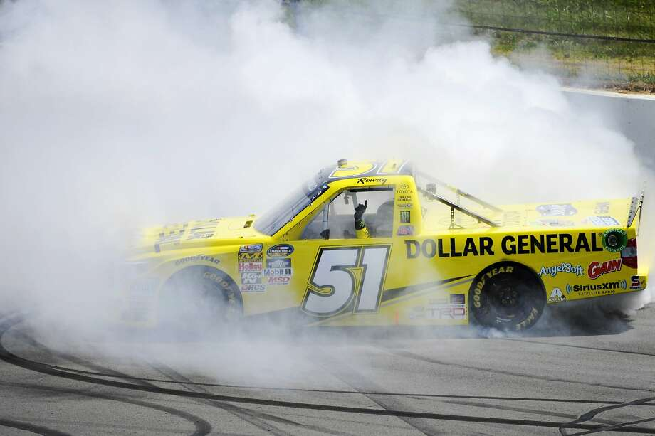 Kyle Busch smokes his tires after winning the Pocono Mountains 150 Truck Series race. Photo: Derik Hamilton, Associated Press