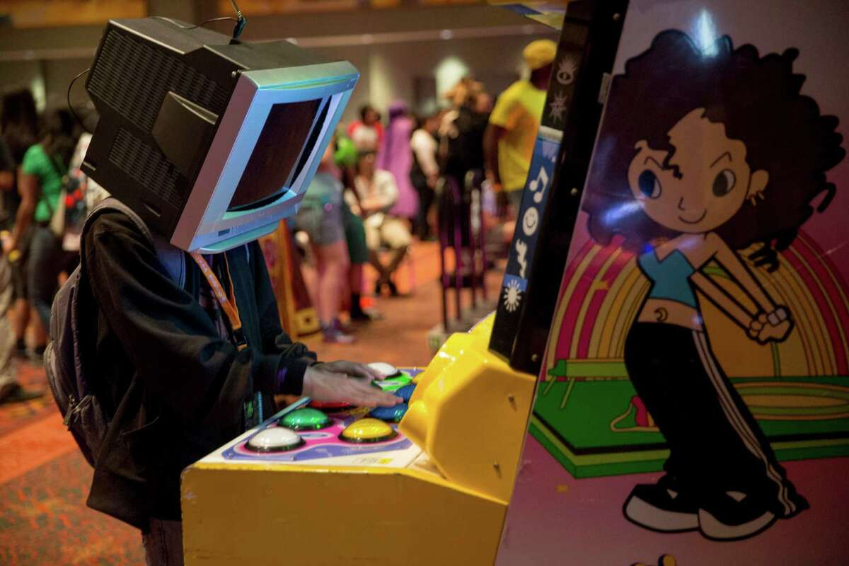 A San Japan attendee plays the Pop'n Music arcade game at San Japan in San Antonio, Texas.