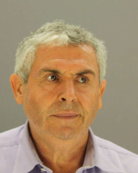 This photo provided by Dallas County Sheriff's office shows Talal Ali Chammout.  Chammout, a 56-year-old Uber driver who served time in federal prison on a weapons conviction has been charged with sexual assault.  Police have accused the Plano, Texas man of sexually assaulting a woman July 25 in her Oak Cliff home after dropping her off.  (Dallas County Sheriff's office via Dallas County Sheriff's office) Photo: Associated Press / Dallas County Sheriff's office