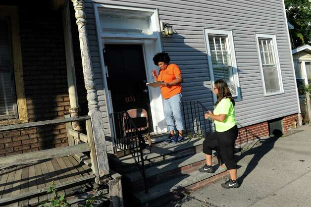 Cathy Edmondson, City School District of Albany community engagement coordinator, left, and Kandie Antonetti, principal of West Hill Middle School, visit a home on Livingston Avenue Extension on Thursday, July 30, 2015, in Albany, N.Y. The school district was registering children who had previously attended Brighter Choice Charter School. Cindy Schultz / Times Union) Photo: Cindy Schultz / 00032809A
