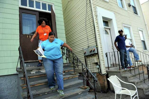 City School District of Albany employees Cathy Edmondson, top left, and Torrie Chapel, center, leave a home on Livingston Avenue on Thursday, July 30, 2015, in Albany, N.Y. The family they were looking for had moved. The school district was registering children who had previously attended Brighter Choice Charter School. Cindy Schultz / Times Union) Photo: Cindy Schultz / 00032809A